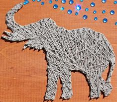 Put a little African safari into your home with this elegant elephant playing in the water. This piece is sure to bring color, vibrancy, and lots of fun into any room! Its perfect for gifts and for yourselves! The Elephant Spraying Water Nail and String art is a unique piece that