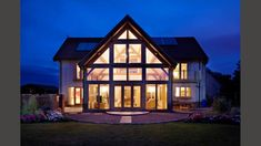 glazed gables, garden exterior view of an Oakwrights gable with lights on