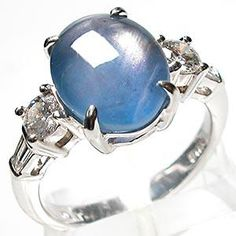 This fine estate ring in solid platinum features a 6.29 carat star blue sapphire. The mounting is accented by .58 carats of round and baguette diamonds. The vintage ring is currently a size 6.5 and in excellent condition. $4,399.00