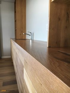 Upstairs kitchenette, solid French oak with continuous grain. Blum undermount drawers and doors, soft close with touch control.