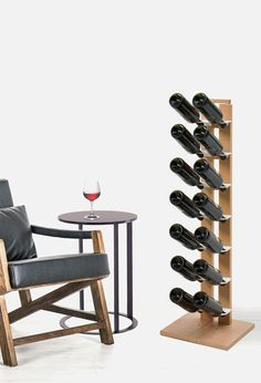 This Wooden bottel display is just the right touch when wanting to show off your wine and liquor choices/ #design #bottel rack #cucina #kitchen #wood #interior