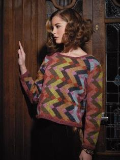 Tanja - Knit this womens intarsia sweater from Rowan Knitting & Crochet Magazine 56, a design by Kaffe Fassett using the ever popular yarn Felted Tweed (merino wool & alpaca). With a wide neck and stocking stitch graphic pattern, this knitting pattern is for the intermediate knitter.