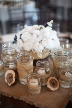 #burlap, #mason-jars, #cotton, #centerpiece  Photography: Aric + Casey Photography - aricandcasey.com Floral Design: Eden\'s Echo - edensecho.com  Read More: http://www.stylemepretty.com/2011/06/20/texas-hill-country-wedding-by-aric-casey-photography/