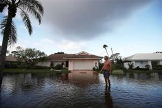 Jerry Darnell stands in front of his house that was flooded by Hurricane Irma