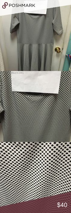 LuLaRoe black & white polka dot Nicole Black & white polka dots. Size 2x but in my opinion fits more like a true XL, I couldn't even get it on. Maybe someone who's a 2x with smaller boobs could fit it, mine are too big for it. LuLaRoe Dresses