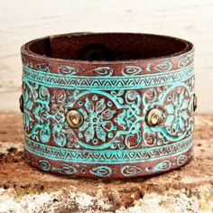 Studded and stamped leather cuff.