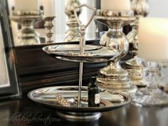 Good Will silver tray turned jewelry display on dresser.
