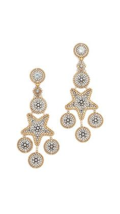 Surprise Sale! Up to 40% off select styles! Ends 11/3! What are you waiting for?!  Stars add playful charm to these long Miguel Ases earrings. Swarovski crystal and pyrite detailing. Post closure.