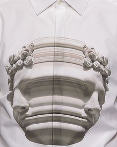 Neil Barrett -       swapped lightning bolts and pixel plaids for stretched statue heads as his signature graphic for S/S 15