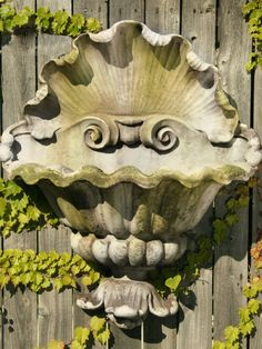 Revitalize a dull exterior wall or architectural niche with this Shell Opera Outdoor Planter. Reminiscent of an open clamshell, this wall-mounted garden planter is an eye-catching garden focal point — both empty and when filled with blooming or cascading foliage.