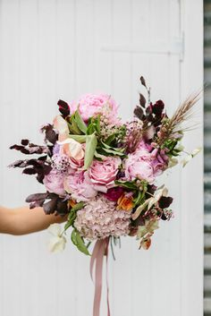 unstructured pink bridal bouquet with hydrangea and peonies