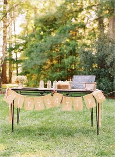 welcome table with diy burlap banner #diy #burlap #weddingchicks http://www.weddingchicks.com/2014/01/29/thrift-savvy-wedding