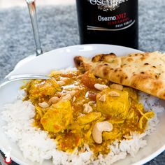 Indian food can be intimidating to make at home. But, if you have a pressure cooker, this coconut milk chicken curry is almost foolproof. #chicken #curry #pressurecooker #rice #coconut #naan #cashews #tomatoes #wine