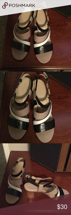 Bandolino Summer  Heels These shoes are in Excellent condition !!! Worn only once!!! The colors are taupe and black and off white!!! Will go great with anything !!! Bandolino Shoes Heels