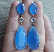 Vergulde zilveren oorbellen met blauw Chalcedoon en Topaas