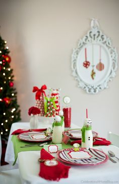 Kids Christmas table; You'll love this kids Christmas table set in classic red and green, with some fun table activities to keep them busy while waiting for the big meal. Get inspired here; childrens Christmas party; kids table Christmas