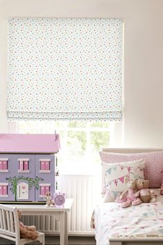Our Celestial Multi Roman blind will have you reaching for the stars thanks to its cute hand-drawn style pattern! Featuring stars and dots in a carnival of colours this blind would be the perfect choice for a child's bedroom.
