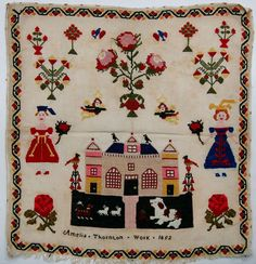An unframed sampler signed Amelia Thornton, 1852; in cross stitch with flowers, a house, dogs, birds and two female figures, with a floral border.