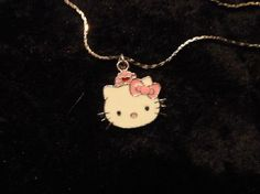 "Adorable Hello Kitty Pendant and 16"" Silver Plated Chain"