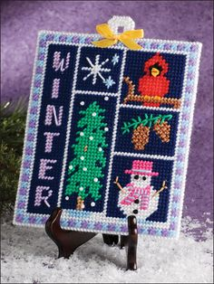 Winter Sampler- (plastic canvas) changed the word winter to our last name. Sign for the camper.