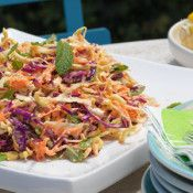Crunchy Slaw - Serve this slaw recipe at any summer BBQ. It makes a great side, plus it's one of the easiest recipes to put together.