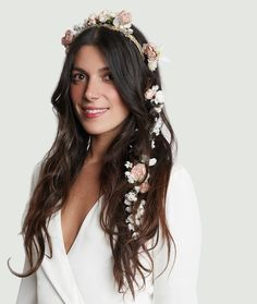 silk flower chain We'll admit it, there's nothing quite like a delicate downpour of dainty florals woven in a soft braid, in lieu of the typical flower crown or veil. This silk flower garland of roses and lilies is a show-stopper to say the least.
