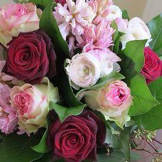 Black Baccara and Esperance roses, Pink ranunculus and hyacinth