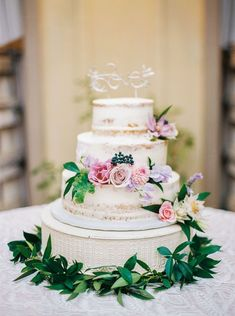 Three tier flower and olive branch wrapped wedding cake: Photography: Danielle Poff Photography - http://www.daniellepoff.com Read More on SMP: http://www.stylemepretty.com/2016/11/09//