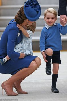 After landing at Victoria airport on Saturday the duchess could be seen squatting down in ...