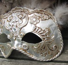 Antique silver mask easily replicated in plastic with lace glued on and sprayed, antiqued.