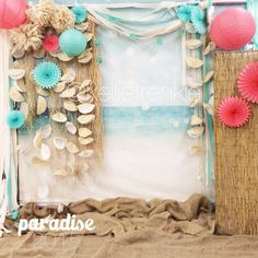 Raffia, paper lanterns, fans, tissue paper streamers, and seashell garland created a sweet backdrop for a paradise themed photo booth for a dance. Aqua, seafoam, coral, ivory, natural reeds, burlap created a muted beachy feel. Perfect for barefoot beach pictures! This would be beautiful for a wedding or reception, parties or other special occasions! #kellietrenkle #photographer #event #photobooth