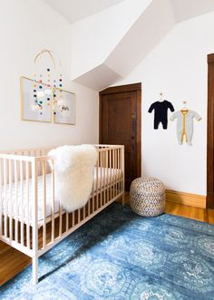 a simple crib, a fur throw and a vintage statement rug are just a few of the pretties making up this gender neutral nursery Photography: Carolina Rodriguez  - carolinamariana.com   Read More on SMP: http://www.stylemepretty.com/2016/02/01//
