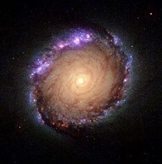 """Barred Spiral Galaxy (NGC 1512) In The """"Constellation Horologium"""" - Composite Ultraviolet Visible Infrared Image"""