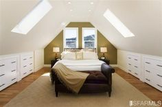 attic master bedroom, how awesome would this be, watching storms thru those skylights!