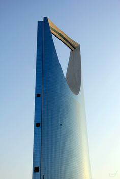 Kingdom Tower, Ryadh, Saudi Arabia  ::  Okay, let's be honest.  It looks like a giant potato peeler.