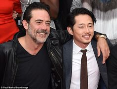 Awkward! Jeffrey Dean Morgan (Negan) and his onscreen victim Steven Yeun (Glenn) embraced showing in real life there is no hard feelings whilst at the Hollywood Forever Cemetery tape Talking Dead after the seventh series premiere of The Walking Dead