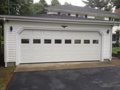 Haas Model 680 Steel Raised Panel Garage Doors In White With Plain Glass.  Installed By