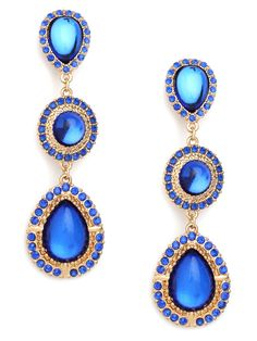Get lost in the beautiful blues of these glamorous drop earrings. There are three tiers worth of sapphire gems, each framed in gold and glittering pav finery.  This is part of the BaubleBar + Nina Garcia Collection