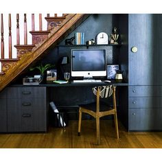 Find out how one family turned the unused space under their stairs into a sleek study nook.