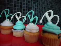 monogrammed cupcakes...same idea for paw print