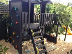Outside play in this fun fort with bridge & rockwall. #play #cubbies #cubbyhouse #outsideplayhouse