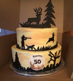 Hunting themed cake. Deer, hunter silhouettes made of fondant
