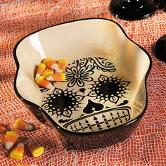 Perfect piece for any halloween or day of the dead party.  Day Of The Dead Candy Dish - OrientalTrading.com
