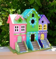 Large wood birdhouse multi family brownstone by VibrantTrains. $29.95, via Etsy.