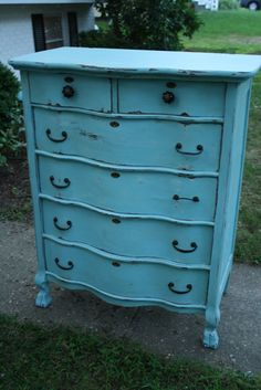 Dresser re-do in a distressed turquoise...maybe do green with ours?