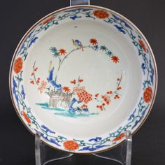 A 17th Century Japanese Kakiemon Bowl c.1670-1690. This Ogee Form Bowl is Decorated in the Classic Kakiemon Style Over a Nigoshide (milky white) Body. The Central Scene is of a `Banded Hedge` with Bamboo with a Bird Perched on it, Prunus and What might be Hydrangea. The Border of Flowering Scroll Work. The Rim is Dressed with a Brown Iron Rich Kuchibeni (Meaning lipstick).