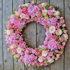 lush pink fresh flower wreath