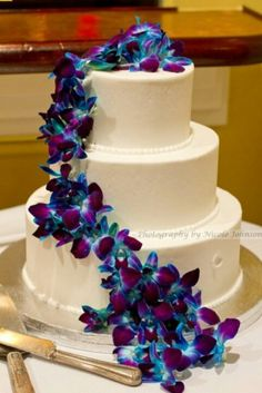 Blue and Purple Orchids on white cake