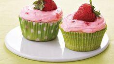 Treat your guests with these lime cupcakes frosted with strawberry cream cheese - a beautiful dessert.