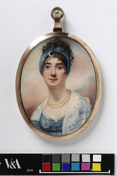 An Unknown woman early 19th century. [Wide blue bandeau from the back hairline, over the ears, to behind the front hairline, with crescent-shaped ornament. Very front hair in short, tiny baby curls. Looks like an off-center (and maybe diagonal) part, with most of the front hair drawn smoothly around the face over the ears. Back hair pulled high in short, messy curls.]
